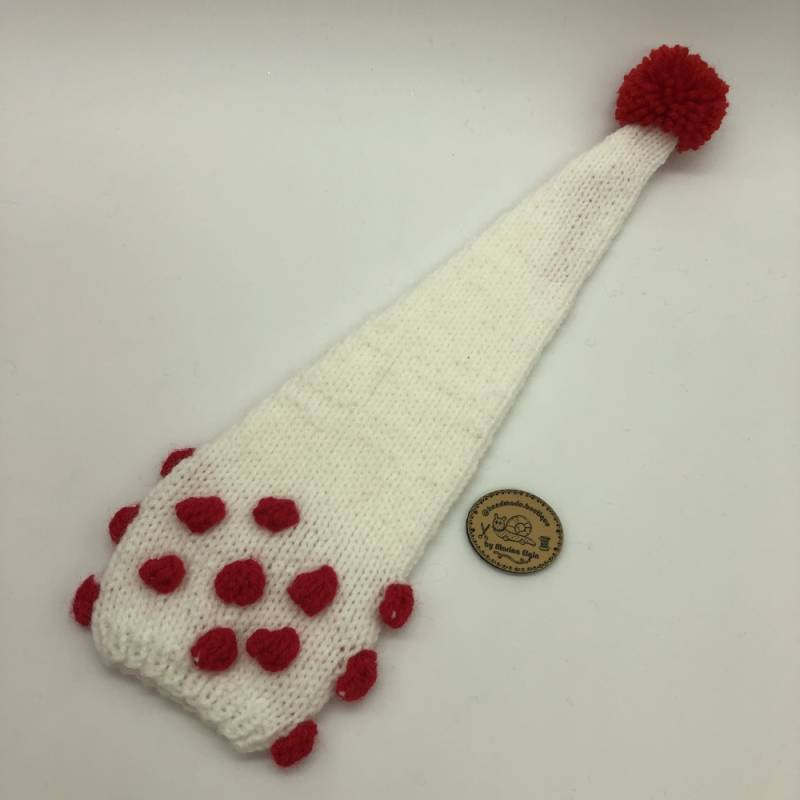 White hat with red points and red pompon
