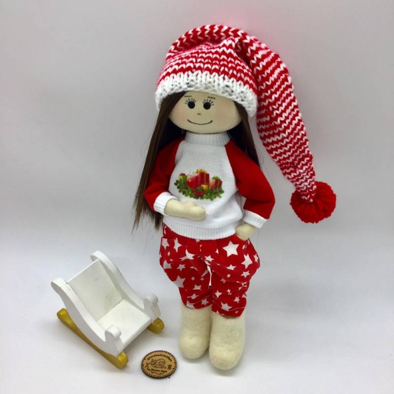 Christmas doll with black hair and black eyes