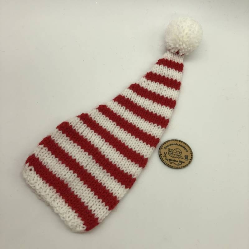 White hat with mid-wide red stripes and white pompon