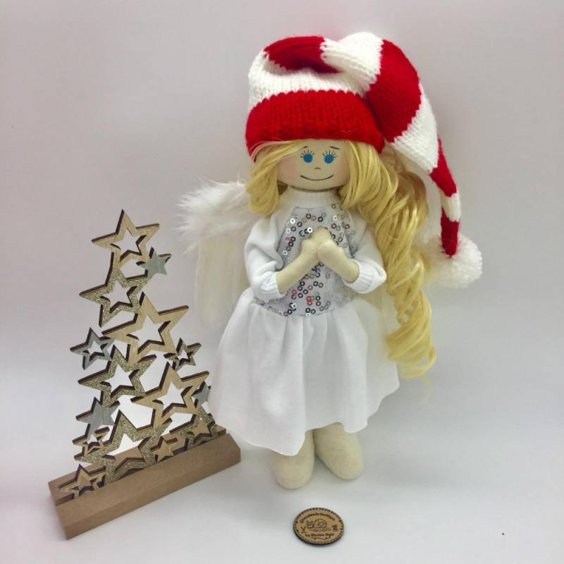 Christmas blonde doll with blue eyes and sparkling dress