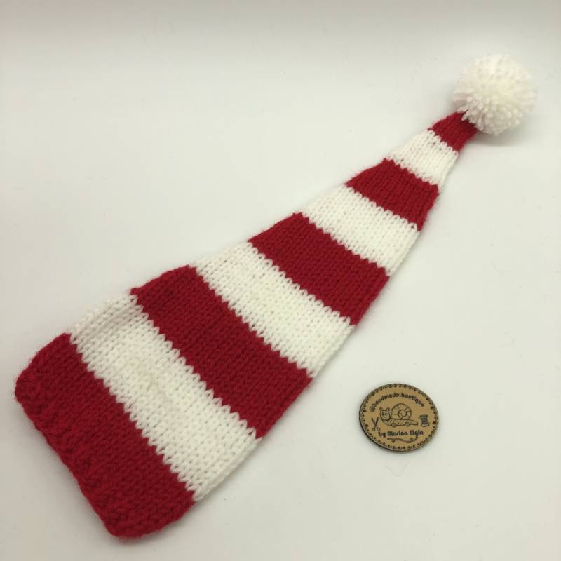 Red white striped hat with white pompon