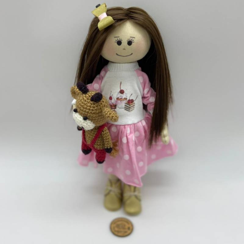 Rag doll with a pink and white dotted dress
