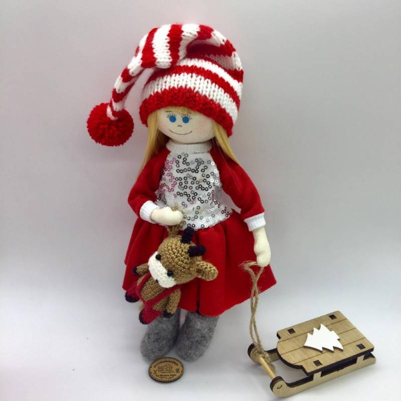 Christmas doll with blond hair and blue eyes