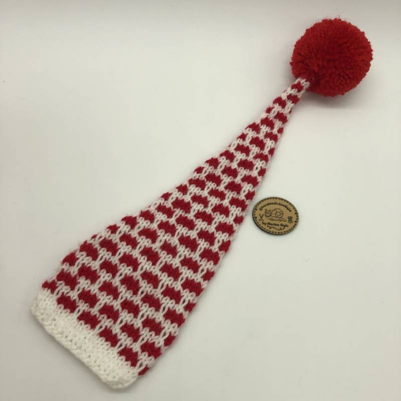 Red white hat with red pompon