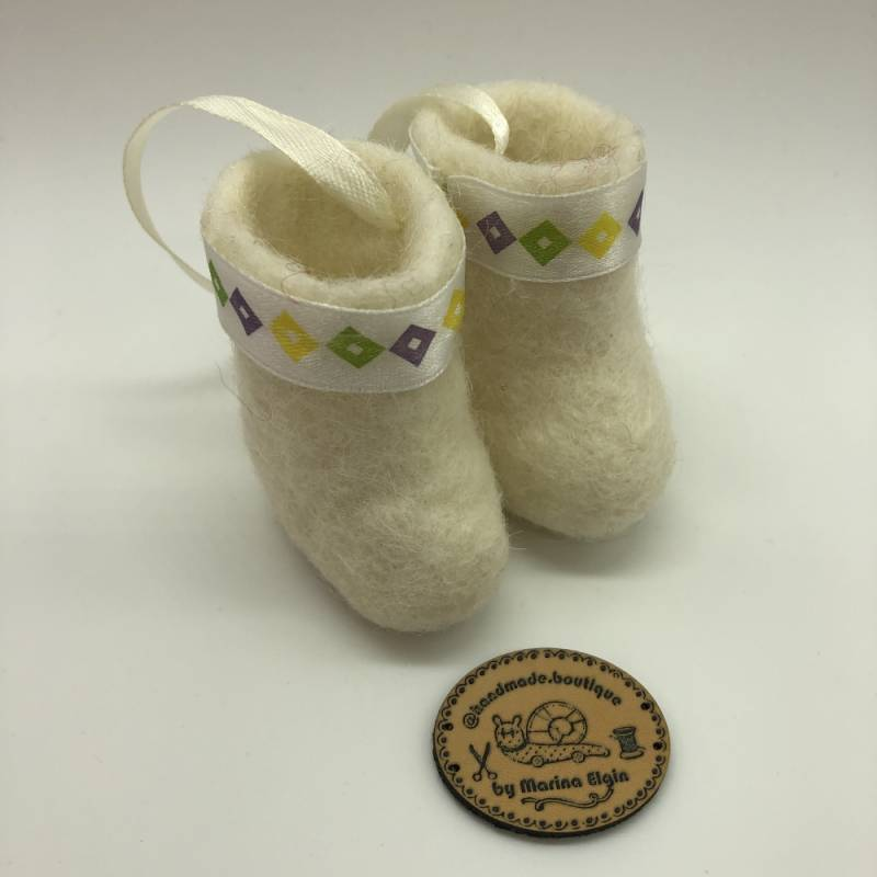White felt shoes with yellow, green and purple pattern